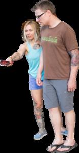 Tattoedcouplepointing