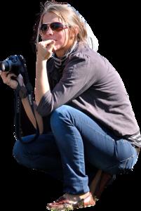 Womankneelingphotographerbitingnails